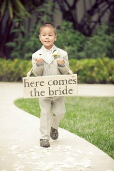 "Ring bearer with ""Here Comes the Bride"" sign. I like this way better than a pillow with fake rings on it."