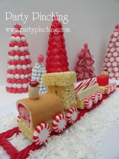 Christmas train made out of Little Debbie Strawberry shortcake rolls and rice krispie treats with starburst candies.  Love this for a centerpiece.