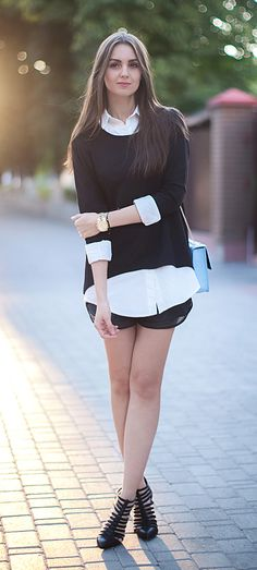 Niki Huk is wearing a black top from TopShop, white shirt from Sheinside, shorts from Bershka and the bag and shoes are both from ASOS