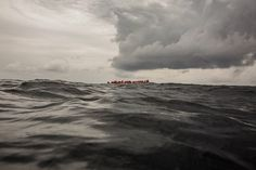 Refugees and migrants wait to be rescued by aid workers from the Spanish NGO Proactiva Open Arms, 60 miles north of Al-Khums, Libya, on Feb. after leaving Libya aboard an overcrowded rubber boat in an attempt to reach European soil. Malta, Mass Migration, Oil Tanker, California Wildfires, Military Personnel, Mediterranean Sea, Album, Color Photography, Continents