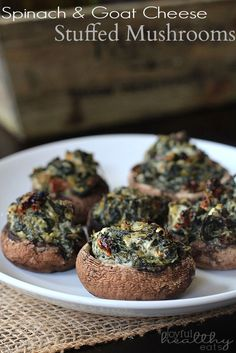 The perfect appetizer for game day or a fancy dinner party! Spinach & Goat Cheese Stuffed Mushrooms | www.joyfulhealthyeats.com