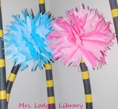 For the past few weeks, I have been planning Dr. Seuss's Birthday Bash for my school.  We will be celebrating Dr. Seuss's birthday with a week of reading celebrations.  To add to the fun, I wanted to incorporate some Dr. Seuss-themed decorations into my library space.  I've seen many cute truffula tree projects on Pinterest so I decided to give truffula trees a whirl. Here is what I came up with:  I'm thrilled with how they came out!  I may have developed a truffula tree addiction and want…