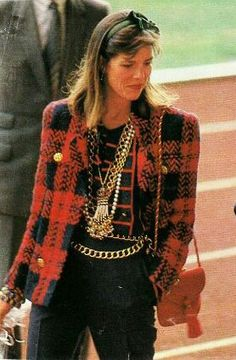 Now that's a terrific outfit. Many chains and fabulous jacket. Well dressed Caroline of Hanover