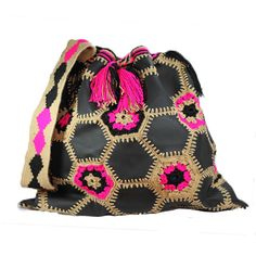 """This #ColombianStyle #handmade #mochila is called """"Leather Mochila Wayúu Hexagonal"""". Two #Wayúu women take approximately 25 days to make it. The bag has a hexagonal leather design in back.  The thread is black, bone and pink colors. The strap is thick with the same colors.  #Colombian #Style offers you #vibrant colors and beautiful patterns that represent the universe and nature. This #bags is a #unique piece of #art."""