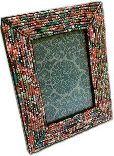 Pier 1 Frame #LooksForLess using Elmer's glue sticks, school glue and a catalog to make paper beads.
