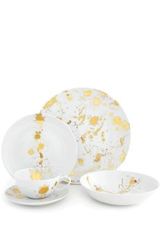 """Chic and classique porcelain dinnerware in a generous scale and friendly coupe shape with a surprising splatter of solid gold. With its all-over splatter pattern the dinner plate is like a sparkly neutral while the other pieces are embellished with a bold composition. This dinnerware is dishwasher safe up to 500 washes so it's formal enough for a holiday table but hardworking for every day.  5 piece dinner set  Dinner Plate: 11.02"""" Diameter  Soup Plate: 8"""" Dia 1.75"""" H  Dessert Plate: 8.27""""…"""