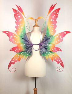 Rainbow colored wings make me ridiculously happy! Colleen design in rainbow colors - client commission All images are copyrighted and are NOT to be con. Colleen Fairy Wings in Rainbow Colors Renaissance Festival Costumes, Girls Dance Costumes, Fairy Costumes, Rainbow Fairies, Diy Wings, Gossamer Wings, Fairy Clothes, Wings Design, Beautiful Fairies