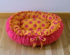 Small Fleece Dog Bed in Orange and Pink Dot. $35.00, via Etsy.