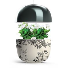 The set includes: Plantui Moomin Garden black. Height Min 20 - Max 50 cm Plantui metal stand Moomin growth book 9 plant capsules + an adapter electrical plug Herb Garden, Indoor Garden, Flower Vases, Flower Pots, Moomin Books, Christmas Wishlist 2016, Biorb, Moomin Valley, Houses