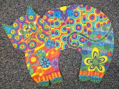 a lesson inspired by the artist Laurel Burch.  Students created their own cats.
