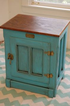 Refinished ice box.  Maybe do a rich red instead, to tie in the tv cabinet?