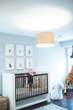 Baby blue nursery with modern crib