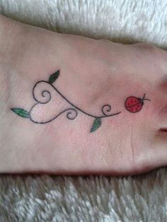 I did it! Day one - cute ladybird tattoo with heart shaped trail/plant stem <3