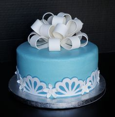 "Blue Birthday Cake - Love those loop bows! And I thought this pattern from the Cricut coordinated nicely. 8"" white cake, vanilla buttercream, vanilla fondant."