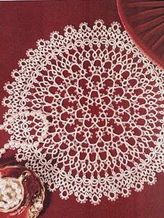 "Ivory Lace Tatted Doily This doily is the result of some experimentation. Keep it up! Size: 8"" diameter.  Skill Level: Intermediate Designed by Darlene Polachic"