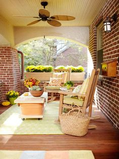 Playful colors make this porch a warm and inviting space. Get more front porch ideas: http://www.bhg.com/home-improvement/porch/porch/porch-design-ideas/?socsrc=bhgpin031413greenporch