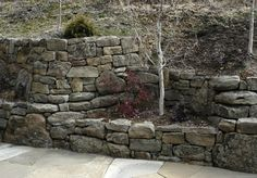 Eagle Moss Rock™ Dry Stack Gallery - Select Stone.   Example of  tiring at different heights for effect.  Tiers do not need to be large, just accessible for weeding.