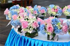 Vintage inspired pink and blue wedding flower arrangements