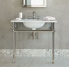 Metal console sink with marble countertop