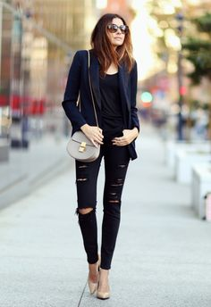 Erica Hoida is wearing black skinny ripped jeans from Frame Denim