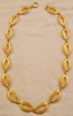 collana pierre cardin in metallo dorato