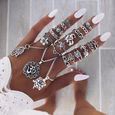 White nails with tanned skin and amazing rings…