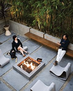 The outdoor space that's ideal for catching up with an old friend. #patio #fireplace