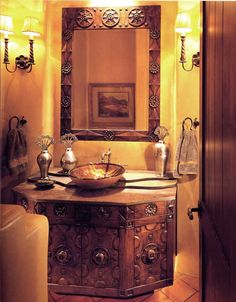 I love the sink cabinet in this gorgeous Tuscan bathroom. Custom Designs By H. J. Nick and Scottsdale Art Factory a handmade in America custom furniture manufacturer based in Scottsdale Arizona. Their door gallery is dream-worthy as well.