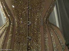 Pearl sheer corset with rhinestone studded bone casings.