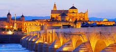 The beautiful city of Cordoba in Spain, glowing in the soft evening lighting [Link in bio]. Merida, City Break Holidays, Tens Place, Spain And Portugal, Grand Tour, Spain Travel, Countries Of The World, Malaga, World Heritage Sites