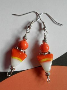 These Candy Corn earrings are made from orange, yellow and white lampwork beads embellished with orange glass and silver tone beads.  I have used 22 gauge bead wire to wire wrap the top and bottom loo