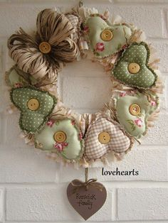 handmade wreath from El taller de Andrea . homespun look with fabric wreaths in pale green prints . wooden buttons and paper ribbon bow . Valentine Wreath, Valentine Decorations, Valentine Crafts, Christmas Decorations, Valentines, Fabric Wreath, Diy Wreath, Sewing Crafts, Sewing Projects