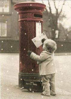 Mailing his Christmas wish list to Santa