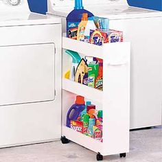 """Roll-Out Laundry Caddy nestles between washer and dryer in a compact three-shelf design. Raised side rails keep everything in place. Sturdy melamine, dual track casters. Assembly required. 25 x 8 3/8 x 31""""."""