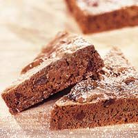Mocha Brownies ~ These fudgy triangles are so rich they require no frosting. The only embellishment needed is a dusting of powdered sugar.