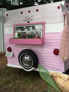 I don't want a pink one, but I would love to have a little trailer like this so I can go glamping.