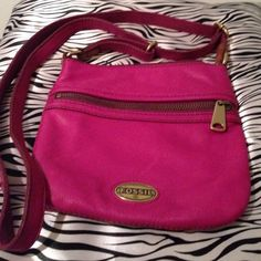 Fabulous Fossil pink cross body bag Fossil pink leather NWOT cross.body bag with adjustable strap. Very nice bag to small for me. There is a zipper pocket on the front with Inside slip pocket and a side zip pocket. The closure zips. Very cute! Fossil Bags Crossbody Bags