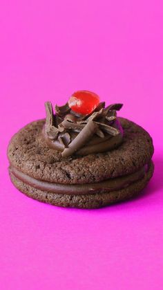 Chewy chocolate cookies, made with cherry brandy and topped with a swirl of chocolate ganache.