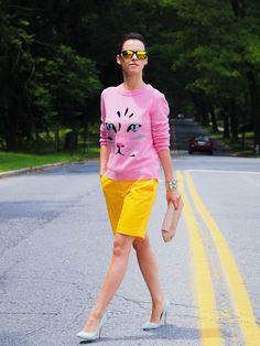pink shirt with yellow bermuda shorts