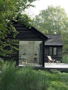 black-cabin-large-window-RUM-Magazine - StyleCarrot