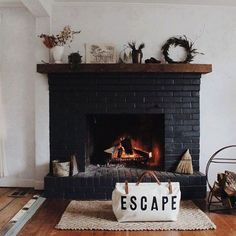 we dig the black fireplace with wood mantle. would paint the existing fireplace Black Brick Fireplace, Painted Brick Fireplaces, Paint Fireplace, Brick Fireplace Makeover, Home Fireplace, Fireplace Remodel, Fireplace Design, Black Fireplace Surround, Fireplace Kitchen