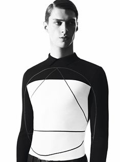 """Dior Homme launches the sixth """"Les Essentiels"""" campaign featuring model Matthew Bell. On jackets as on sweaters, a trigonometric motif appears in Trompe-l'œil and stands out as a primary code for the winter season."""