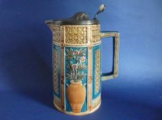 Large Wedgwood Majolica 'Luther' Pewter Lidded Aesthetic Movement Jug c1884