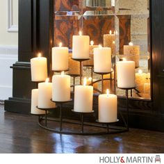 This glamorous metal candelabra is the perfect feature to adorn any shelf or mantel. With ten platforms to hold candles and a sturdy base, this metal candelabra will add warmth and a gentle glow to an
