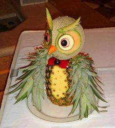 Healthy kids' birthday party food: the fruit owl.  All it needs is a pineapple, rockmelon, zucchini, carrot, cherry and a bit of creative flair!