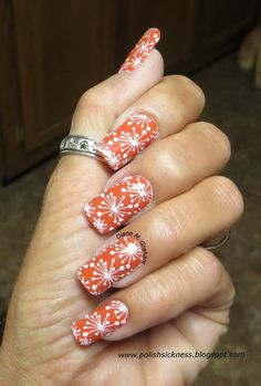 Stunning orange and white paint splatter manicure by Diane Moran Graham.