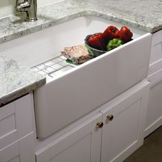 Give your kitchen a stunning centerpiece with this farmhouse kitchen sink from Highpoint. This 30-inch single bowl sink has a classic white finish and includes a drain and grid. Made of fireclay, this sink has a 10-inch apron height to make a statement.