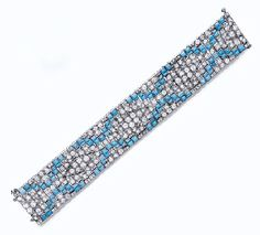 AN ART DECO TURQUOISE AND DIAMOND BRACELET circa 1925.  OEC diamonds and cabochon turquoise mounted in platinum.  christies.com