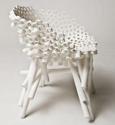 Meltdown' chairs by Tom Price is made by heating and fusing together common plumbing tubes, clothing, polypropylene sheets, PVC rope and hoses.