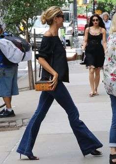 Heidi Klum was a classic beauty in flared denim, an off-the-shoulder black top and MCM crossbody bag. Simple black sunnies and a casual bun completed her effortless look.� (Photo by Ignat/Bauer-Griffin/GC Images)  via @AOL_Lifestyle Read more: http://www.aol.com/article/2016/07/03/sexy-stars-pippa-middleton-bella-hadid-and-jourdan-dunn-wow-in/21423351/?a_dgi=aolshare_pinterest#fullscreen